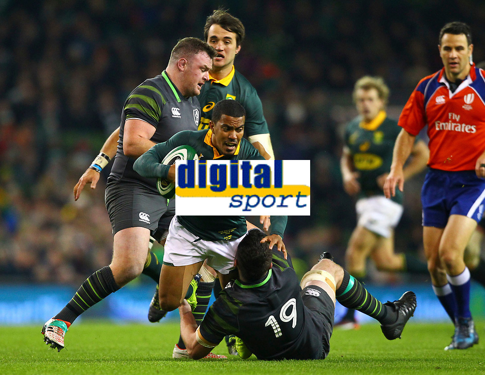 Rugby Union - 2017 Guinness Series (Autumn Internationals) - Ireland vs. South Africa<br /> <br /> South Africa's Rudy Paige is tackled by Ireland's James Ryan, at the Aviva Stadium.<br /> <br /> COLORSPORT/KEN SUTTON