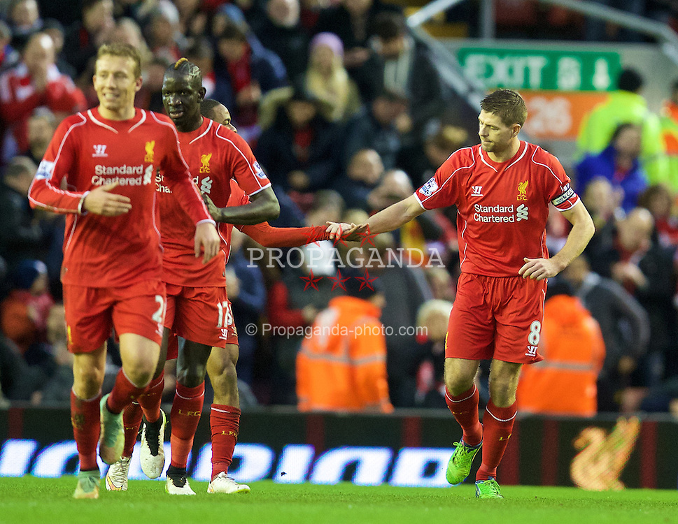 LIVERPOOL, ENGLAND - Thursday, New Year's Day, January 1, 2015: Liverpool's captain Steven Gerrard celebrates scoring the first goal against Leicester City from the penalty spot during the Premier League match at Anfield. (Pic by David Rawcliffe/Propaganda)