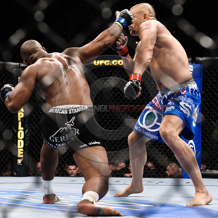 "ATLANTA, GEORGIA, SEPTEMBER 6, 2008: Rashad Evans (left) throws an overhand right to the head of Chuck Liddell during ""UFC 88: Breakthrough"" inside Philips Arena in Atlanta, Georgia on September 6, 2008"