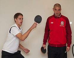 CARDIFF, WALES - Tuesday, September 4, 2012: Wales' David Edwards and goalkeeper Boaz Myhill during a players' table tennis tournament at the St. David's Hotel ahead of the Brazil 2014 FIFA World Cup Qualifying Group A match against Belgium. (Pic by David Rawcliffe/Propaganda)