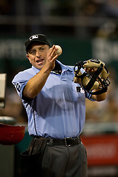 OAKLAND, CA - SEPTEMBER 23:  MLB umpire Chris Guccione #68 stands on the field during the fifth inning between the Oakland Athletics and the Los Angeles Angels of Anaheim at O.co Coliseum on September 23, 2014 in Oakland, California. The Los Angeles Angels of Anaheim defeated the Oakland Athletics 2-0.  (Photo by Jason O. Watson/Getty Images) *** Local Caption *** Chris Guccione