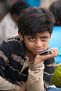 A sad Azharuddin Ismail, 10, the child actor playing the role of 'young Salim', the brother of Jamal, protagonist of Slumdog Millionaire, the famous movie winner of 8 Oscar Academy Awards in December 2008, is sitting near his home inside the slum where he and his family still live next to the train station of Bandra (East), Mumbai, India. Various promises were made to lift the two young actors (Azharuddin Ismail and Rubina Ali) from poverty and slum-life but as of the end of May 2009 anything is yet to happen. Rubina's house was recently demolished with no notice as it lay on land owned by the Maharashtra train authorities and she is now permanently living with her uncle's family in a home a stone-throw away in the same slum. Azharuddin's home too was demolished in the past two weeks, as it happens every year in his case, because the concrete walls were preventing local authorities to clear a drain passing right behind it. As usual, his father is looking into restoring the walls as soon as the work on the drain has been completed.