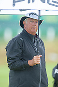 Kirk Triplett shelters from the rain during the final round of the Rolex Senior Golf Open at St Andrews, West Sands, Scotland on 29 July 2018. Picture by Malcolm Mackenzie.