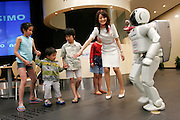 ASIMO the robot that can run, is created by HONDA. Here in the HONDA showroom in Aoyama.