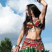 Hackney All Nations. Linda from Bulgaria.  Dancers entertain visitors to the floating market on the canal throughout the Olympics