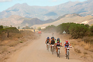 VILLIERSDORP, SOUTH AFRICA - second place ladies team WSP Jeep, Robyn Adendorff and Sarah van Heerdenlead some men during stage two, of the Absa Cape Epic Mountain Bike Stage Race held in Villiersdorp on the 23 March 2009 in the Western Cape, South Africa..Photo by Sven Martin  /SPORTZPICS