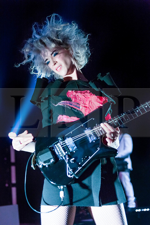 © Licensed to London News Pictures. 20/02/2014. London, UK.   St Vincent performing live at Shepherds Bush Empire. St Vincent (Annie Erin Clark)  is an American singer-songwriter and multi-instrumentalist who has in the past been a  member of The Polyphonic Spree and also Sufjan Stevens' touring band.  Photo credit : Richard Isaac/LNP