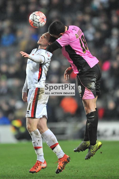 NORTHAMPTONS DAVID BUCHANAN BEATS OF MK DONS SIMON CHURCH, MK Dons v Northampton Town, FA Cup Emirates FA Cup Third round Repay, Stadium MK, Tuesday 19th January 2016