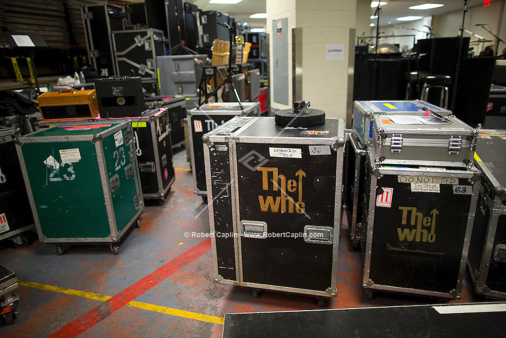 "Road Cases and equipment backstage. ""12-12-12?, a fundraising concert to aid the victims of Hurricane Sandy, will take place on December 12, 2012 at Madison Square Garden. The concert featured The Rolling Stones, Bon Jovi, Eric Clapton, Dave Grohl, Billy Joel, Alicia Keys, Chris Martin, Bruce Springsteen & the E Street Band, Eddie Vedder, Roger Waters, Kanye West, The Who, and Paul McCartney. All the proceeds went go to the Robin Hood Relief Fund. Robin Hood, the largest independent poverty fighting organization in the New York area, will insure that every cent raised will go to non-profit groups that are helping the tens of thousands.of people throughout the tri-state area who have been affected by Hurricane Sandy...Photo © Robert Caplin.."