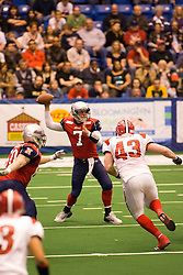 14 March 2009: Mitch Tanney unloads a pass when challenged by an untouched defender - Leif Murphy. The Sioux Falls Storm were hosted by the Bloomington Extreme in the US Cellular Coliseum in downtown Bloomington Illinois.