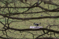 "© Licensed to London News Pictures. 07/12/2019. Gerrards Cross, UK. A drone sits in a field prior to takeoff as London's Metropolitan Police Service searches woodland in Gerrards Cross, Buckinghamshire. Police have been in the area conducting operations since Thursday 5th December 2019 and are searching two areas on Hedgerley Lane. In a press statement a Metropolitan Police spokesperson said ""Officers are currently in the Gerrards Cross area of Buckinghamshire as part of an ongoing investigation.<br /> ""We are not prepared to discuss further for operational reasons.""<br /> Photo credit: Peter Manning/LNP"