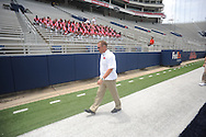 Mississippi head coach Hugh Freeze walks to join the team photo during the team's media day, in Oxford, Miss. on Friday, August 1, 2014. Mississippi begins practice Saturday morning and opens the season against Boise State in Atlanta on August 28, 2014.