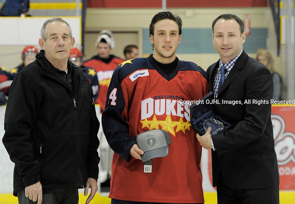WELLINGTON, ON - Nov 17 : Ontario Junior Hockey League Game Action between Wellington Dukes and Aurora Tigers. Marty Savoy presents Mike Soucier with the September player of the month award. Wellington Dukes Hockey Club Team Governor Don Cotton to left.<br /> (Photo by Amy Deroche / OJHL Images)