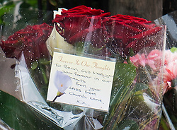 """© London News Pictures. 24/08/2013. Kilburn, UK. Flowers and note reading """"To Bean, God bless you, your forever inn our hearts. From your LADS  from Church Lane""""  left at the scene of a double shooting  in which one woman has died and another woman was injured. Photo credit: Ben Cawthra/LNP"""