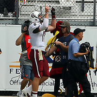 South Carolina Gamecocks quarterback Dylan Thompson (17) celebrates a touchdown during an NCAA football game between the South Carolina Gamecocks and the Central Florida Knights at Bright House Networks Stadium on Saturday, September 28, 2013 in Orlando, Florida. Thompson replaced starting quarterback Connor Shaw who was injured in the first quarter. (AP Photo/Alex Menendez)
