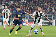 Manchester United Forward Alexis Sanchez battles with Juventus Midfielder Miralem Pjanic during the Champions League Group H match between Juventus FC and Manchester United at the Allianz Stadium, Turin, Italy on 7 November 2018.