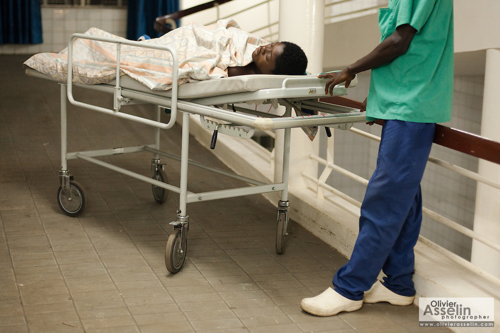 Aminata Sisay, who says she's 15, lies on a stretcher after undergoing c-section surgery at the Princess Christian Maternity Hospital in Freetown, Sierra Leone on Monday April 26, 2010. Aminata waited too long before coming to the hospital, and lost her child, who needed to be removed from her womb through surgery.