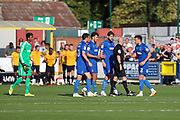 AFC Wimbledon players surround ref after the second goal during the EFL Sky Bet League 1 match between AFC Wimbledon and Bristol Rovers at the Cherry Red Records Stadium, Kingston, England on 21 September 2019.