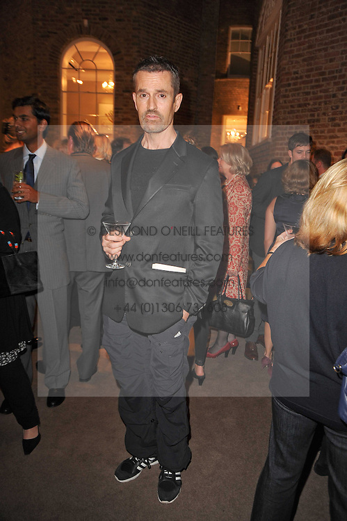 RUPERT EVERETT at a party to celebrate the publication of Inheritance by Tara Palmer-Tomkinson at Asprey, 167 New Bond Street, London on 28th September 2010.