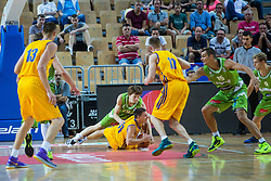 Jaka Klobucar of Slovenia vs Denis Lukashenkov of Ukraine during friendly basketball match between National teams of Slovenia and Ukraine at day 1 of Adecco Cup 2015, on August 21 in Koper, Slovenia. Photo by Grega Valancic / Sportida