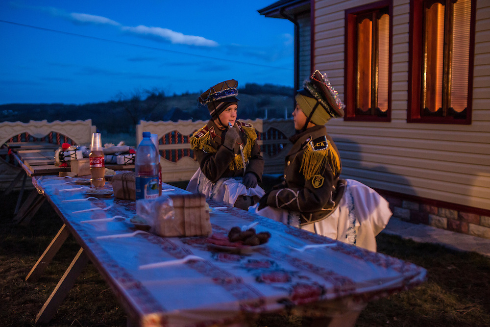 Todor Mytyk, 10, left, and Petrya Velia, 11, wearing costumes to celebrate the Malanka Festival which began at sundown on Wednesday, January 13, 2016 in Krasnoilsk, Ukraine. The celebrations, which consist of costumed villagers going in a group from house to house singing, playing music, and performing skits, will last all night and until the following evening.