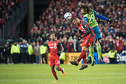 December 9, 2017 - Toronto, Ontario, Canada - Toronto FC defender JUSTIN MORROW (2) heads the ball away from Seattle Sounders defender ROMAN TORRES (29) while Toronto FC midfielder ARMANDO COOPER (31) during the MLS Cup championship match at BMO Field in Toronto, Canada.  Toronto FC defeats Seattle Sounders 2 to 0. (Credit Image: © Mark Smith via ZUMA Wire)