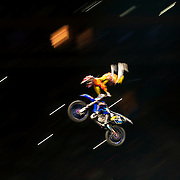 January 8, 2014 - New York, NY : Nitro Circus, an action/extreme sports show starring Travis Pastrana, made its Madison Square Garden debut in Manhattan on Wednesday night. Pictured here, Jarryd McNeil performs a stunt on a motocross bike during the show. CREDIT : Karsten Moran for The New York Times **SEE LICENSING  RESTRICTIONS IN INSTRUCTION FIELD**
