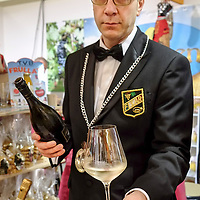 A sommelier holds a glass of Prosecco Wine at one of the stands of the Biennale del Gusto on October 28, 2013 in Venice, Italy. The Biennale del Gusto is an exhibition held over four days, dedicated to traditional food and drinks from all regions of Italy.