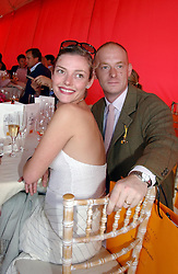 Actress CAMILLA RUTHERFORD and MR RUFUS ABBOTT at the Veuve Clicquot sponsored Gold Cup or the British Open Polo Championship won by The  Azzura polo team who beat The Dubai polo team 17-9 at Cowdray Park, West Sussex on 18th July 2004.