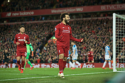 LIVERPOOL, ENGLAND - Friday, April 26, 2019: Liverpool's Mohamed Salah celebrates scoring the fifth goal during the FA Premier League match between Liverpool FC and Huddersfield Town AFC at Anfield. (Pic by David Rawcliffe/Propaganda)