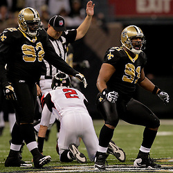 2009 November 02: New Orleans Saints defensive end Will Smith (91) celebrates after sacking Atlanta Falcons quarterback Matt Ryan (2) during the first half at the Louisiana Superdome in New Orleans, Louisiana.