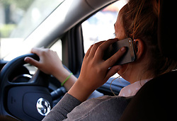 NOTE POSED BY MODEL File photo dated 13/08/14 of a woman using a mobile phone while driving. A road safety campaign aimed at stopping people using their phone while driving has been launched in Scotland.