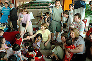 After the official ceremony at the US Consulate, parents set up their adopted children in the lounge of the White Swan hotel for the traditional group photo.