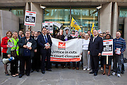Elfyn Llwyd MP and Hywel Williams MP pose with the PCS union members protesting outside the MOJ. The current Conservative government are proposing to close103 Magistrates Court and 54 County Courts in the UK as part of their current budget cut plans. PCS union members protest about job losses through court closures outside the Ministry of Justice (MOJ) building, central London. 15th September 2010.