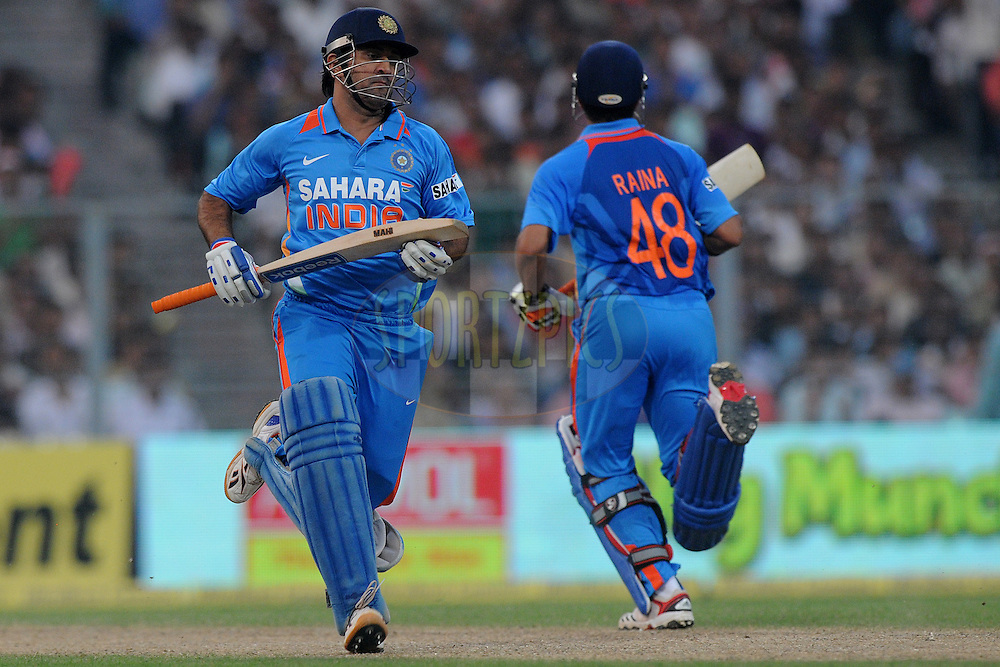 Mahendra Singh Dhoni captain of India  bats during the 5th One Day International ( ODI ) match between India and England held at the Eden Gardens Stadium, Kolkata on the 23rd October 2011..Photo by Pal Pillai/BCCI/SPORTZPICS