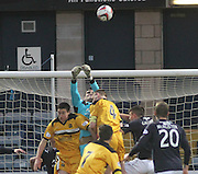 Kyle Letheren punches clear-under pressure from Andy Graham - Dundee v Dumbarton, SPFL Championship at Dens Park<br /> <br />  - &copy; David Young - www.davidyoungphoto.co.uk - email: davidyoungphoto@gmail.com