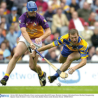24 July 2005; Declan O'Rourke, Clare, in action against David O'Connor, Wexford. Guinness All-Ireland Senior Hurling Championship Quarter-Final, Wexford v Clare, Croke Park, Dublin. Picture credit; Brendan Moran / SPORTSFILE