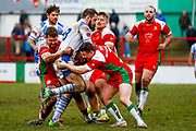 Workington Town second row Gordon Maudling (18) is tackled during the Betfred League 1 match between Keighley Cougars and Workington Town at Cougar Park, Keighley, United Kingdom on 18 February 2018. Picture by Simon Davies.