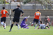 Peacehaven Layton Schaaf scores the opener during the Pre-Season Friendly match between Peacehaven & Telscombe and Luton Town at the Peacehaven Football Club, Peacehaven, United Kingdom on 18 July 2015. Photo by Phil Duncan.