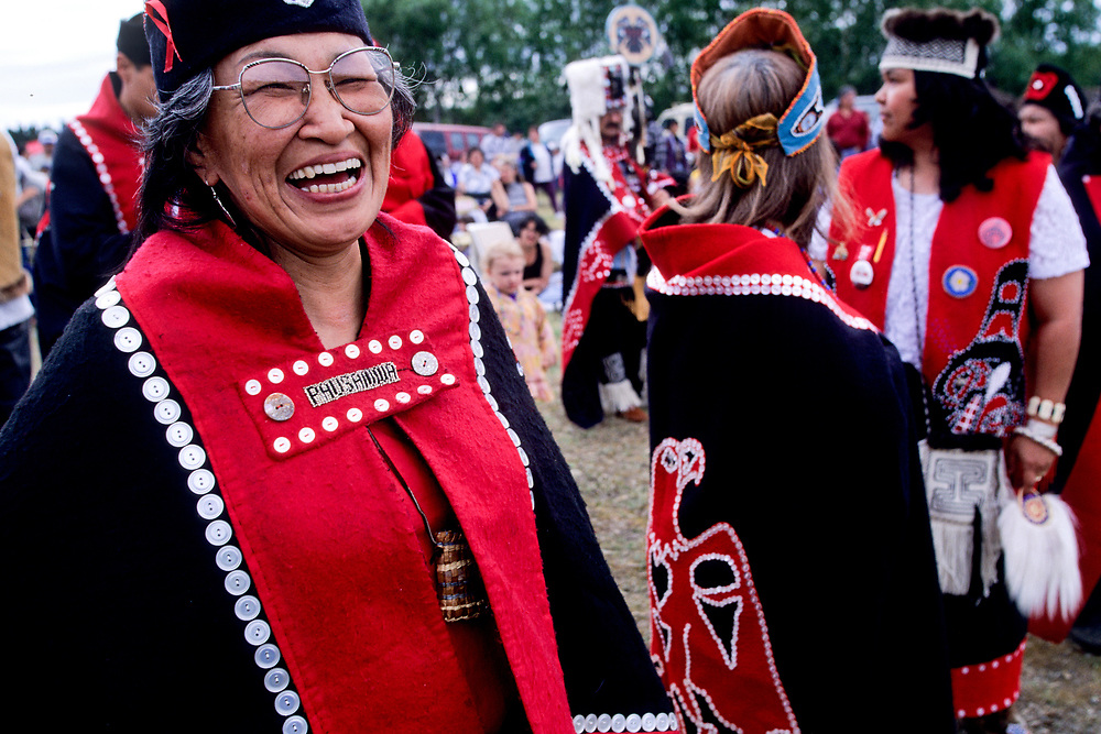 Alaska native elder woman in traditonal buttoned Tlingit costume smiling
