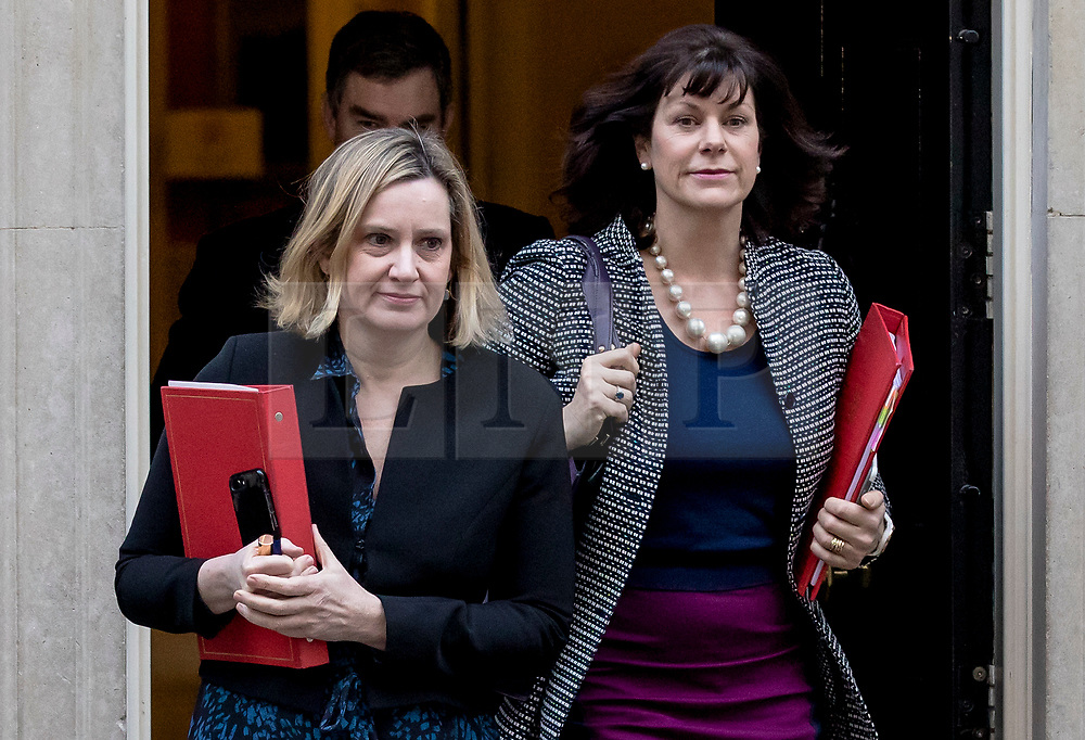 """© Licensed to London News Pictures. 26/02/2019. London, UK. Secretary of State for Work and Pensions Amber Rudd (L) and Minister of State at Department for Business, Energy and Industrial Strategy Claire Perry (R) leave 10 Downing Street after the Cabinet meeting. Both ministers have suggested that they would consider resigning from government in order to vote against the possibility of a """"no deal"""" Brexit. Photo credit: Rob Pinney/LNP"""