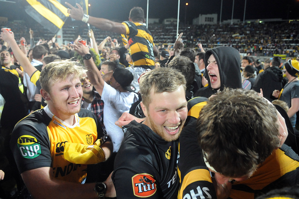 Fans mob the platers after Taranaki defeated the Tasman Makos in the ITM Cup Rugby Premiership final match at Yarrow Stadium, New Plymouth, New Zealand, Saturday, October 25, 2014. Credit:SNPA / Ross Setford