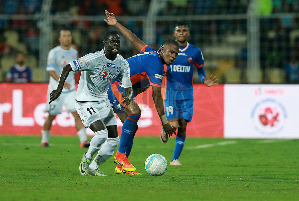 Momar Ndoye of FC Pune City and Trindade Goncalves of FC Goa in action  during match 8 of the Indian Super League (ISL) season 3 between FC Goa and FC Pune City held at the Fatorda Stadium in Goa, India on the 8th October 2016.<br /> <br /> Photo by Vipin Pawar / ISL/ SPORTZPICS
