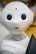 Pepper is the first humanoid robot designed to live with humans and has the ability to read emotions. The robot is made by SoftBank Mobile and Aldebaran Robotics. Tokyo, Japan.<br /> Copyright 2015 CHRISTINA SJOGREN
