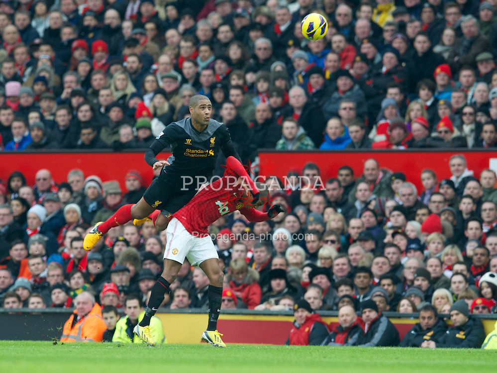 MANCHESTER, ENGLAND - Sunday, January 13, 2013: Liverpool's Glen Johnson in action against Manchester United's Ashley Young during the Premiership match at Old Trafford. (Pic by David Rawcliffe/Propaganda)