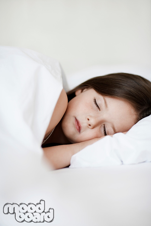 Little Girl Sleeping in bed close up