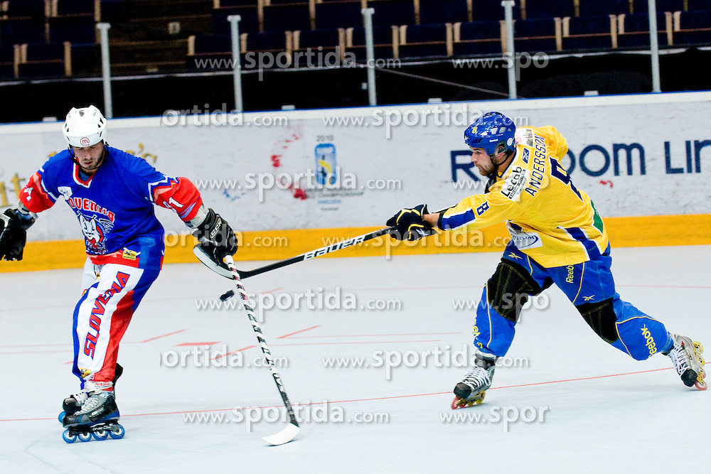 Jimmy Andersson, 8, of Sweden blocked by Denis Kadic, 91, of Slovenia at Game 8 of IIHF In-Line Hockey World Championships Top Division Group match between National teams of Sweden and Slovenia on June 29, 2010, in Karlstad, Sweden. (Photo by Matic Klansek Velej / Sportida)