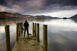 July 21, 2019 - A Woman Standing On A Wooden Pier, Lake Derwent, Cumbria, England (Credit Image: © John Short/Design Pics via ZUMA Wire)