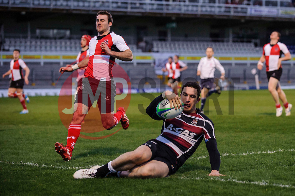 University of Bristol Winger (#11) Steffan Jones goes over to score a brilliant individual try during the first half of the match - Photo mandatory by-line: Rogan Thomson/JMP - Tel: Mobile: 07966 386802 - 29/04/2013 - SPORT - RUGBY - Memorial Stadium - Bristol. University of Bristol v University of the West of England - 2013 edition of the annual Rugby Union University Varsity match in Bristol.