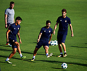 SEVILLE, SPAIN - AUGUST 21:  Joaquin Correa of Sevilla FC (L) and Ever Banega of Sevilla FC (C) in action during the training session prior to their UEFA Champions League match against Istambul Basaksheir at the Sevilla FC training ground on August 21, 2017 in Seville, Spain.  (Photo by Aitor Alcalde Colomer/Getty Images)